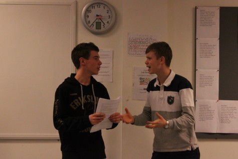 Two grade 10 students perform a play.