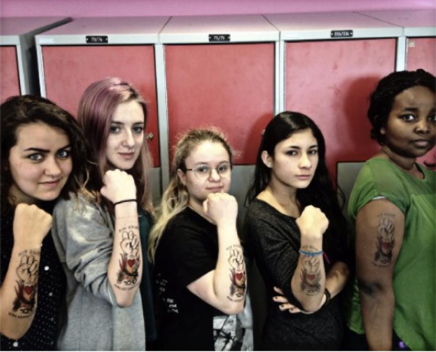 Amnesty Activists show off their tough tattoos