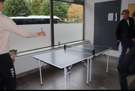 Students playing table tennis.